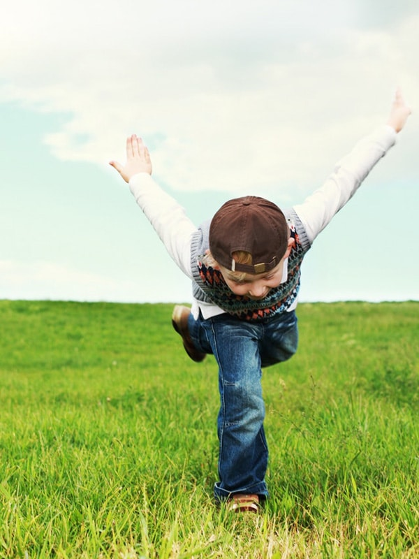 Child playing in an open field
